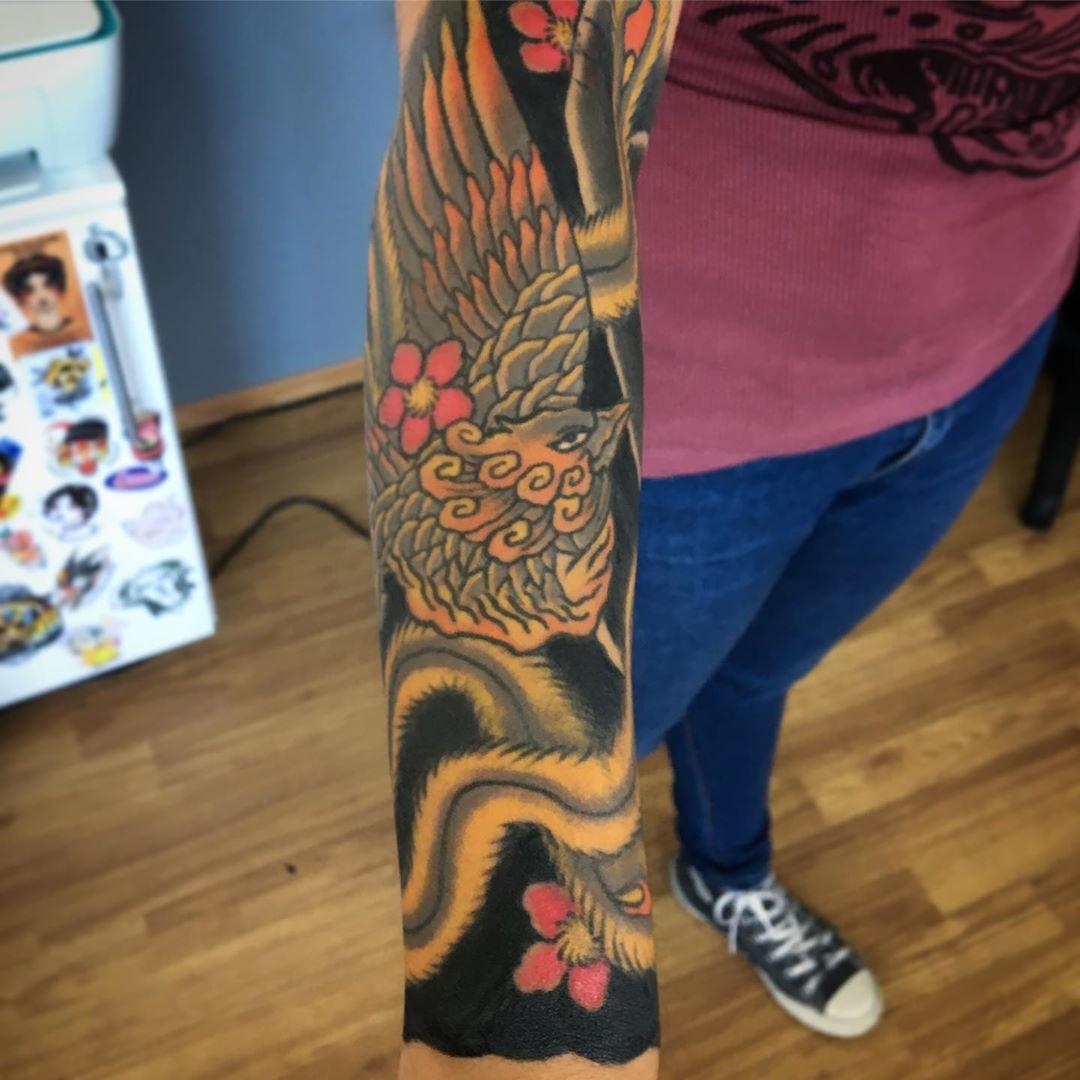 matias-lemu-tattoo-arm-black-neotraditional
