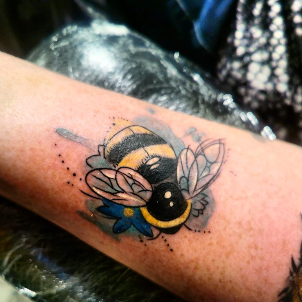 joakim-poulsen-tattoo-bee-arm