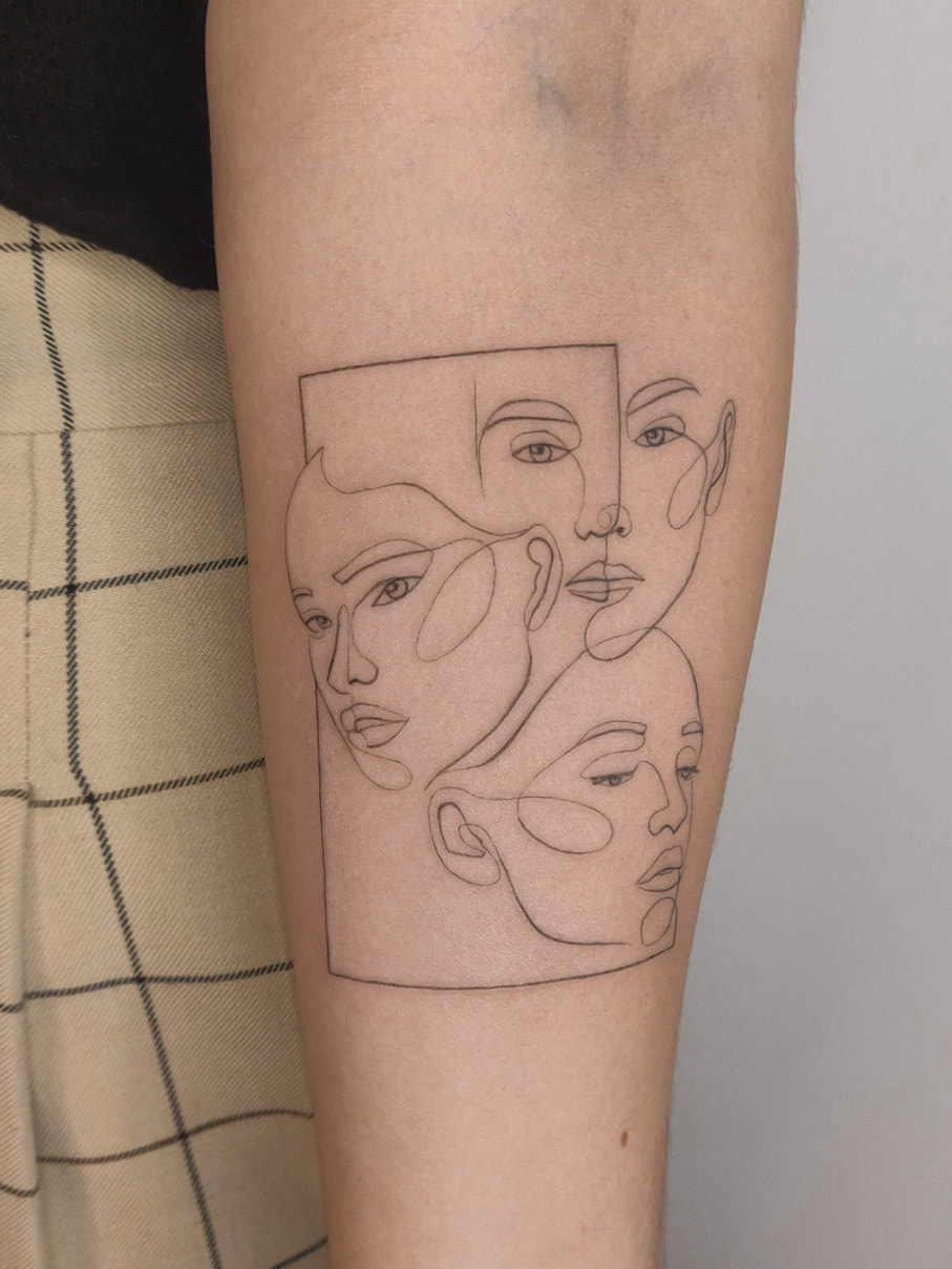 agus-coll-tattoo-artist-oneline-3-faces-arm