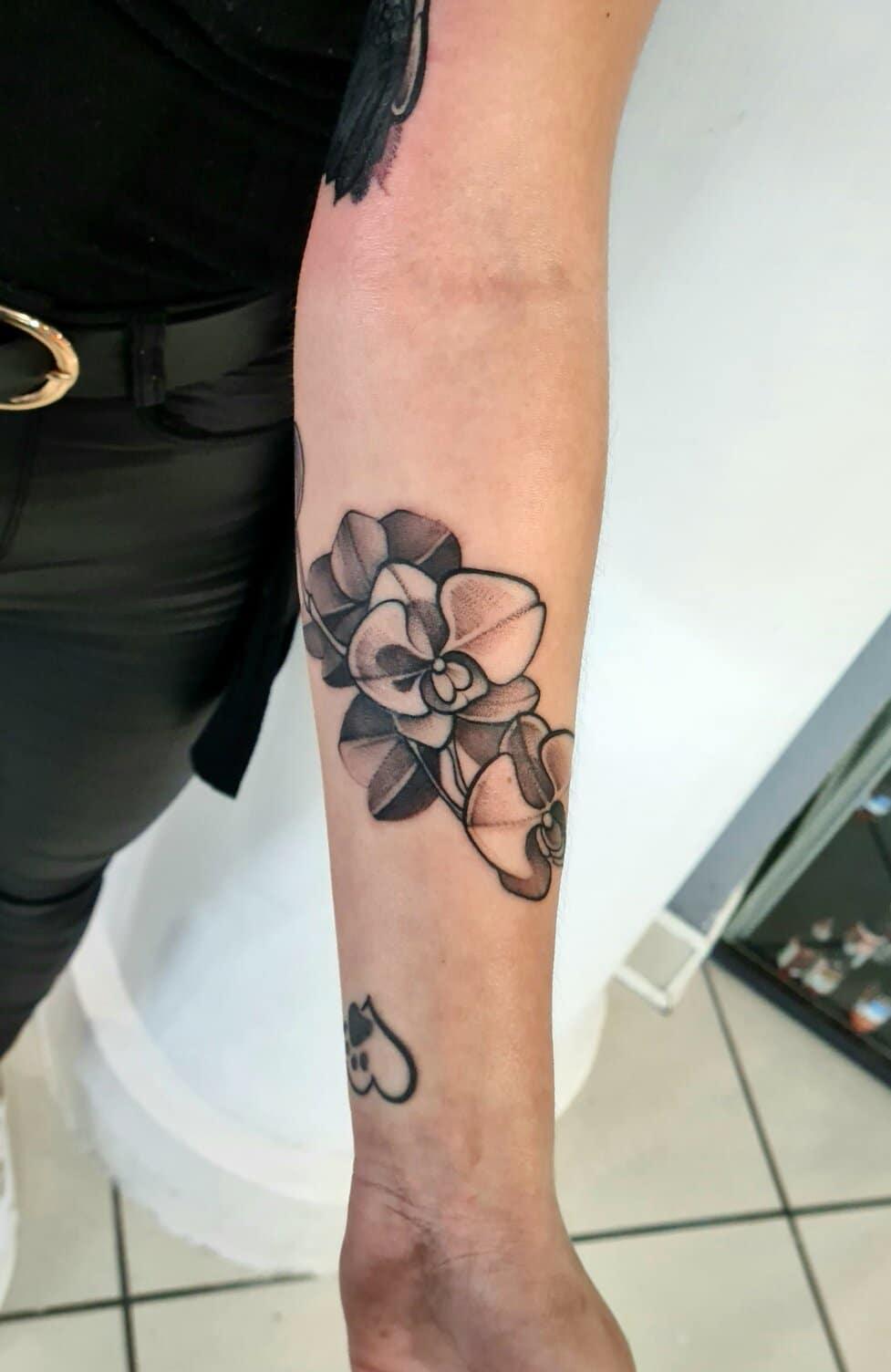 sara derbis tattoo artists flower arm