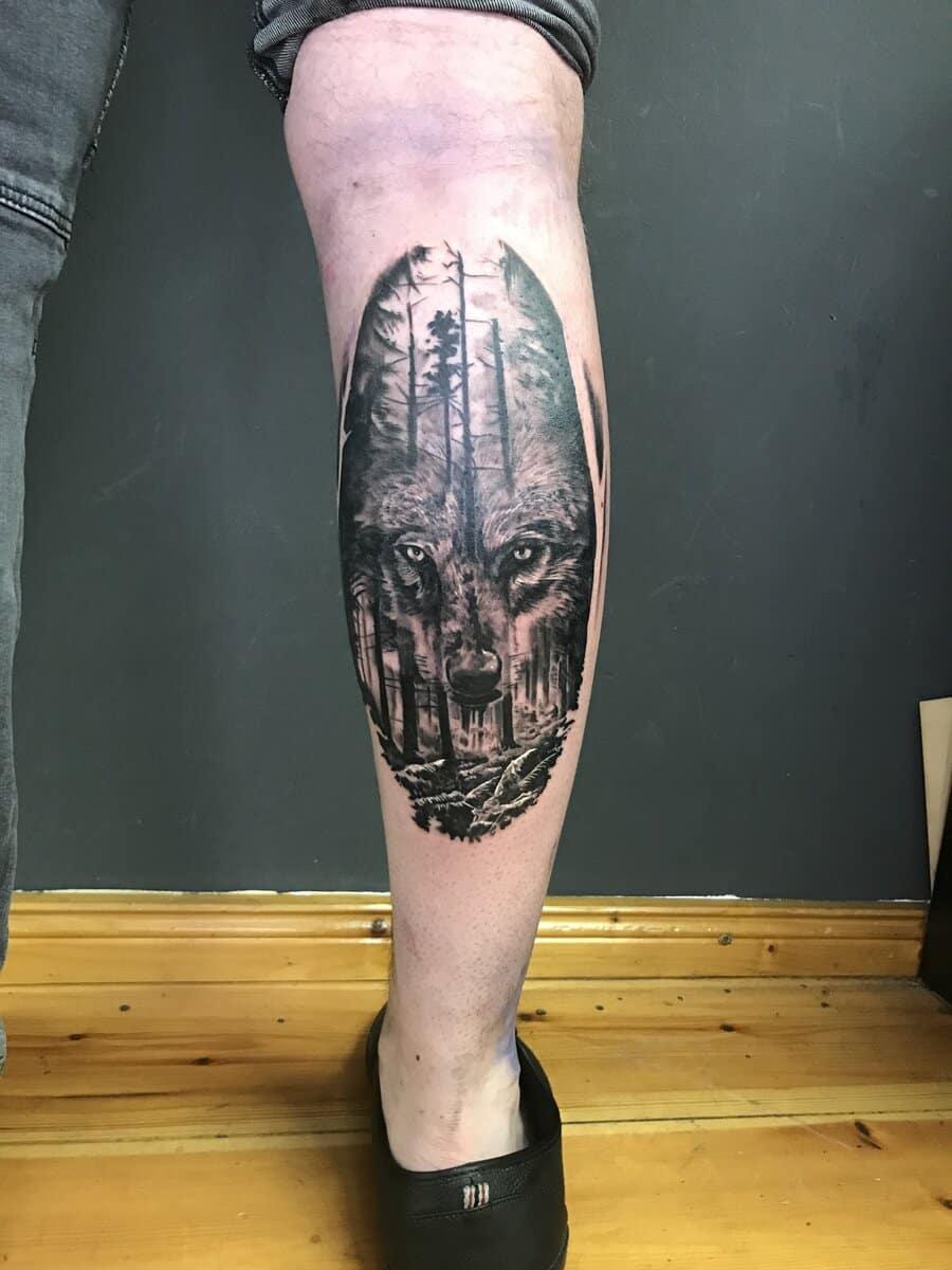 gui art work tattoo studio wolf leg realism