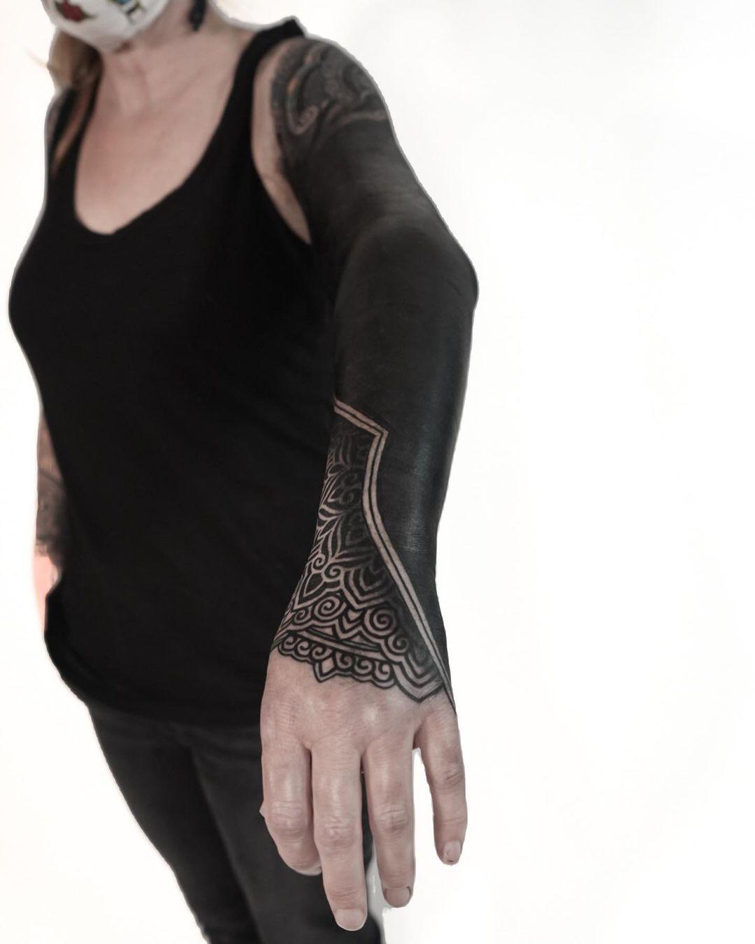 blackout-tattoos-arm-ornamental