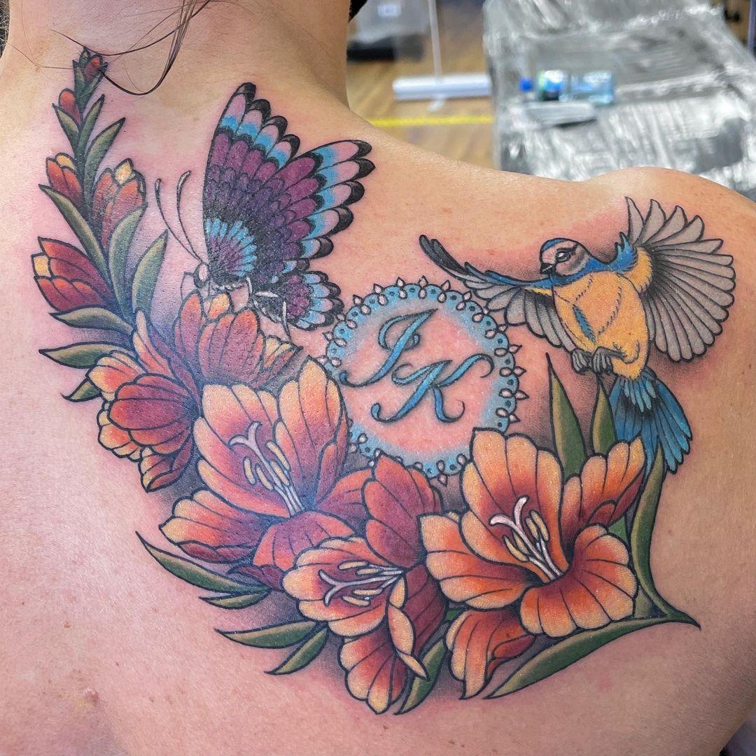 miss-rie-newport-tattoo-artits-flower-colors-bird
