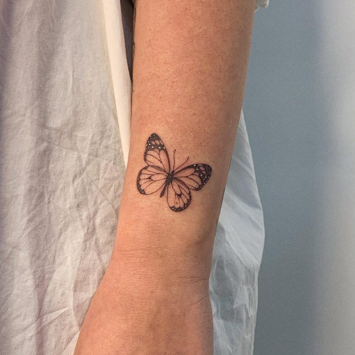 blanka bartosova tattoo artist butterfly arm