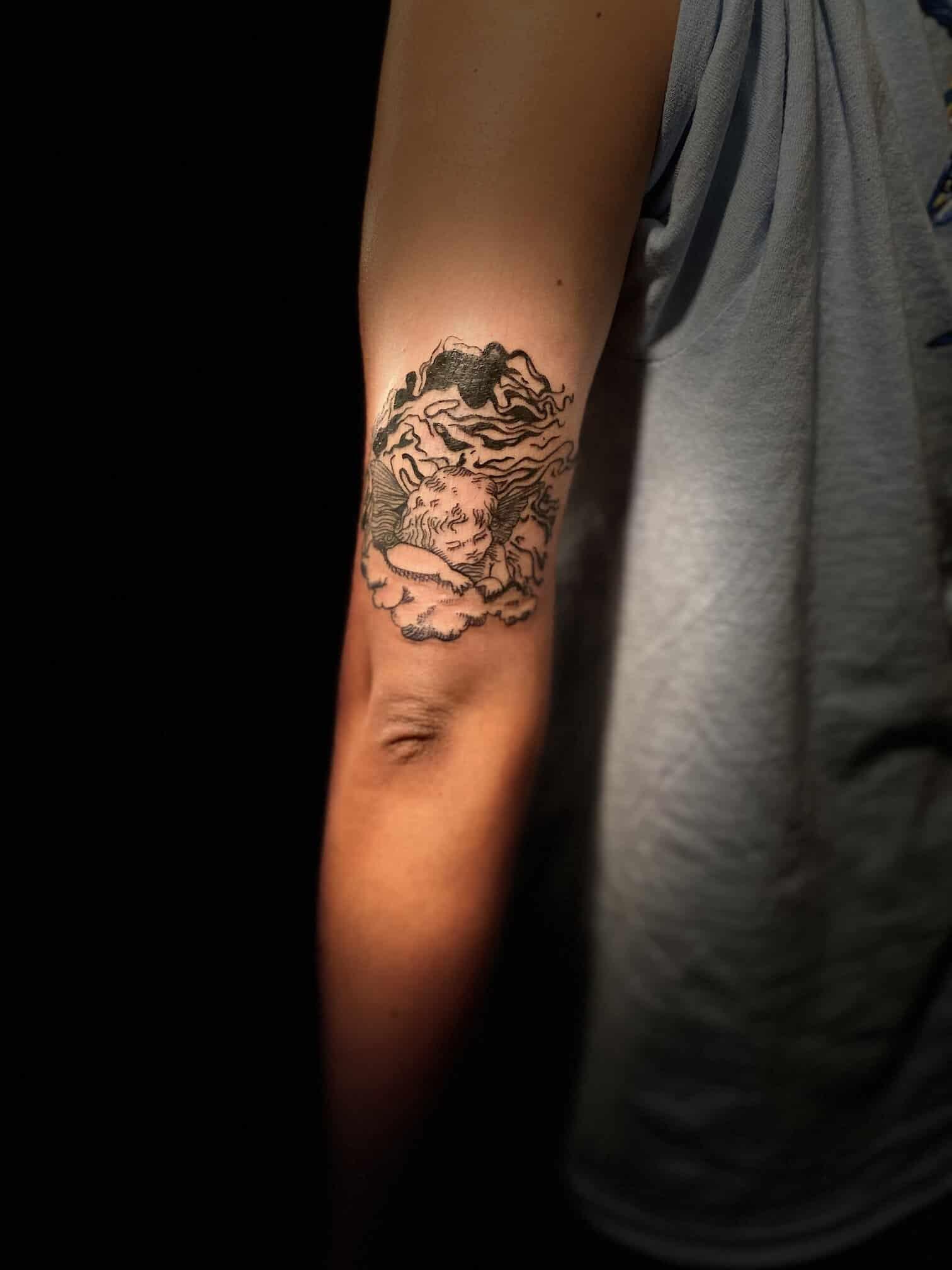 kristal-haze-tattoo-artist-angel-arm