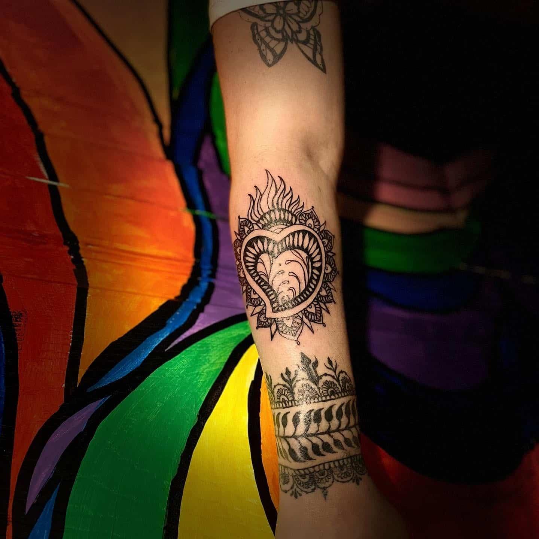 kristal haze tattoo artist heart arm